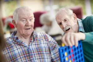 residents play connect four in Aldersmead Care Home